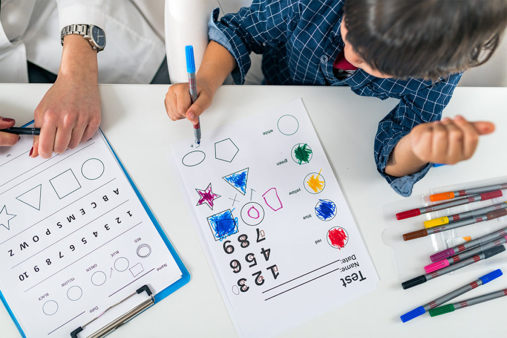 Child coloring a test